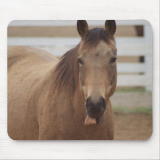 Horse sticking tongue out mouse mat
