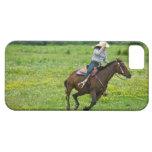 Horseback rider galloping in rural pasture iPhone 5 case