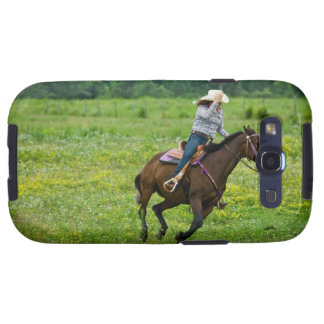 Horseback rider galloping in rural pasture galaxy SIII case