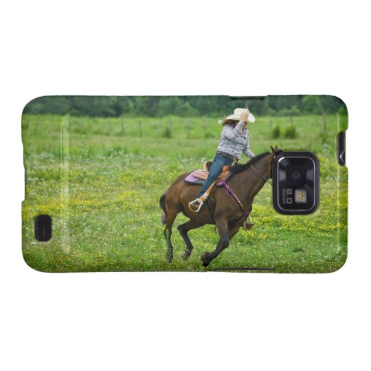 Horseback rider galloping in rural pasture galaxy SII case