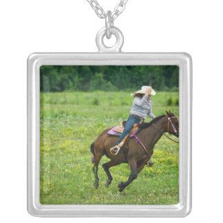 Horseback rider galloping in rural pasture square pendant necklace