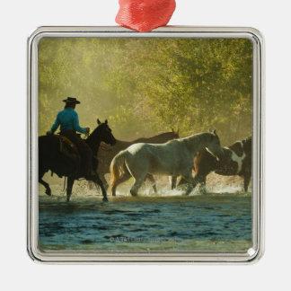 Horseback rider herding horses metal ornament