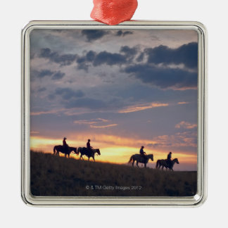 Horseback riders at sunset 2 metal ornament