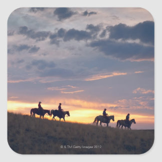 Horseback riders at sunset 2 square sticker