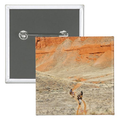 Horseback riders on trail 2 inch square button