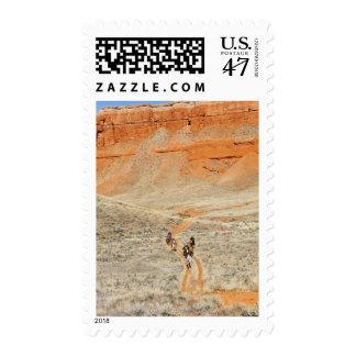 Horseback riders on trail postage stamp