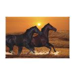 Horses at sunset canvas print
