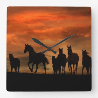Horses at sunset running clock