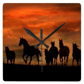 Horses at sunset running clock wall clocks