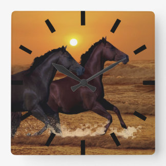 Horses at sunset square wall clock