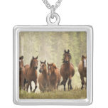 Horses cresting small hill during roundup, 2 square pendant necklace