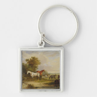 Horses Grazing: A Grey Stallion grazing with Mares Key Chain