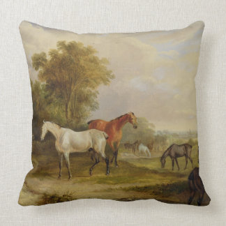 Horses Grazing: A Grey Stallion grazing with Mares Throw Pillow