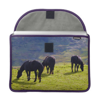 Horses Grazing On The Field MacBook Pro Sleeves