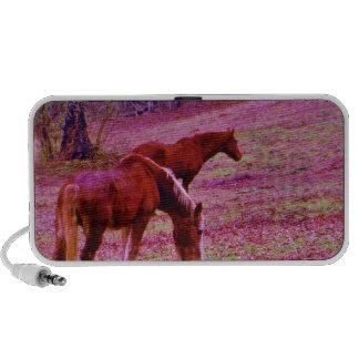 Horses in a lavender purple pink field, notebook speakers