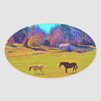Horses in a Rainbow Colored Field Oval Sticker