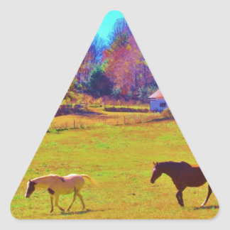 Horses in a Rainbow Colored Field Triangle Sticker