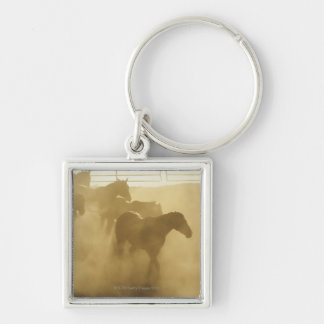 Horses in corral keychain