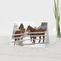 Horses looking over fence in snow holiday card
