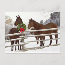 Horses looking over fence in snow holiday postcard