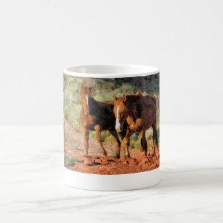 Horses roaming in Monument Valley, UT Coffee Mug