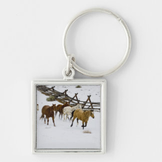Horses Running in Snow Keychain