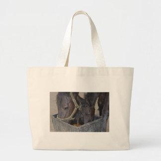 Horses sharing jumbo tote bag
