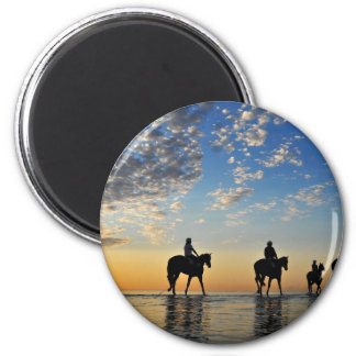 horses with riders walking on the sea at sunset 2 inch round magnet