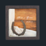 "Horseshoe and Satin Country Western Wedding Gift Box<br><div class=""desc"">Customize the charming Horseshoe and Satin Country Western Wedding Gift Box with the personal names of the bride and groom and specific marriage ceremony date. Create a personalized keepsake wedding gift for the newlyweds or thank you present for your wedding attendants, bridesmaids and bridal party. This pretty little box is...</div>"