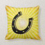 Horseshoe; yellow throw pillows
