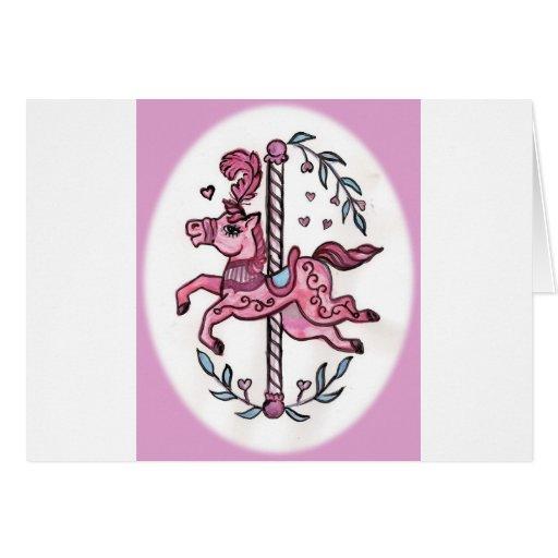Horsie rosado del tiovivo felicitaciones