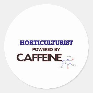 Horticultor accionado por el cafeína etiqueta redonda