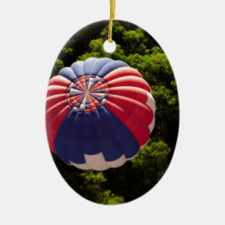 Hot Air Balloon Ballooning Above The Trees Double-Sided Oval Ceramic Christmas Ornament