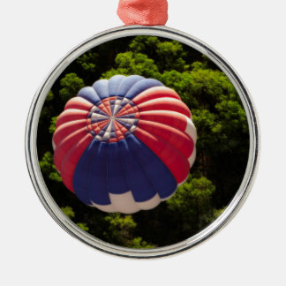 Hot Air Balloon Ballooning Above The Trees Round Metal Christmas Ornament