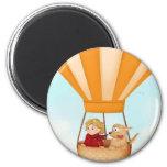 Hot air balloon girl and dog refrigerator magnet