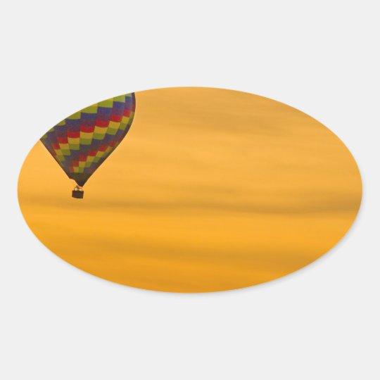 Hot Air Balloon Golden Sky Oval Sticker