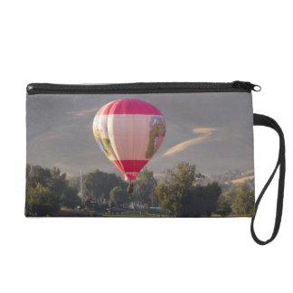 Hot air balloon over the Yakima River Wristlet Purse