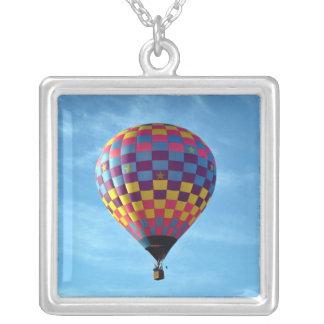 Hot air balloon sails away into the sky pendants