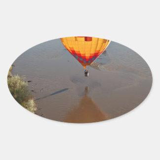 Hot Air Balloon Touching Rio Grande River Oval Sticker