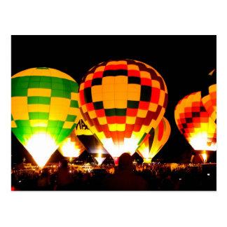 Hot Air Balloons Glowing at Night Postcard