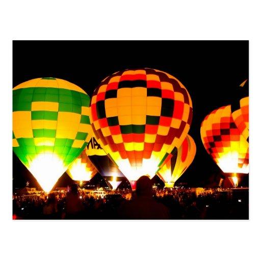 Hot Air Balloons Glowing at Night Post Card