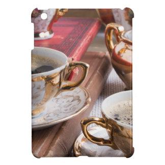 Hot coffee and retro crockery for breakfast iPad mini cover