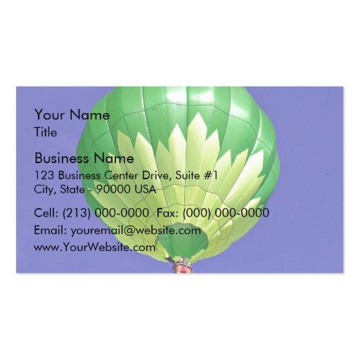 Hot dual tone air balloon in flight against blue s business card