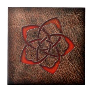 Hot orange celtic flower on leather ceramic tile