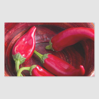 Hot red chili peppers on a fabric background rectangular sticker
