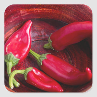 Hot red chili peppers on a fabric background square sticker