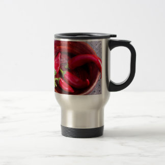 Hot red chili peppers on a fabric background travel mug