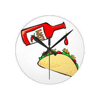 Hot sauce dripping on taco round clock