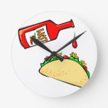 Hot sauce dripping on taco wallclock