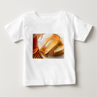 Hot toast with butter on a white plate close-up baby T-Shirt